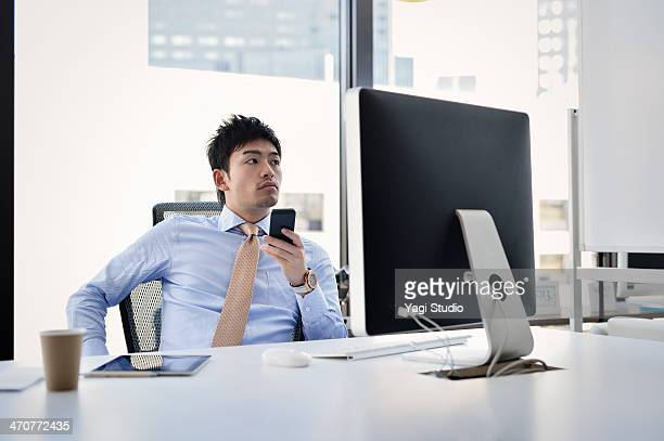 Businessman working on Smartphone in office