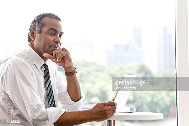 Businessman working on tablet device