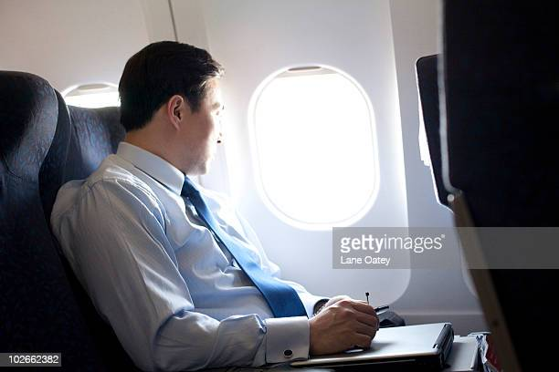 Businessman working on the plane