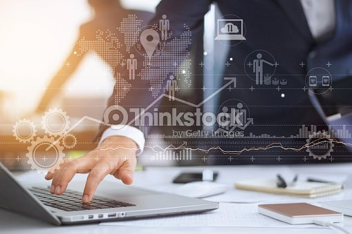 Businessman working using laptop computer with strategy and growth of business on screen : Stock Photo