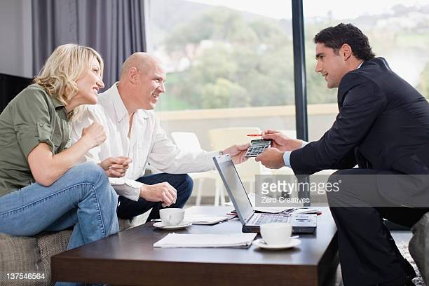 Businessman working with couple