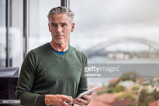 Businessman working with the digital tablet in office