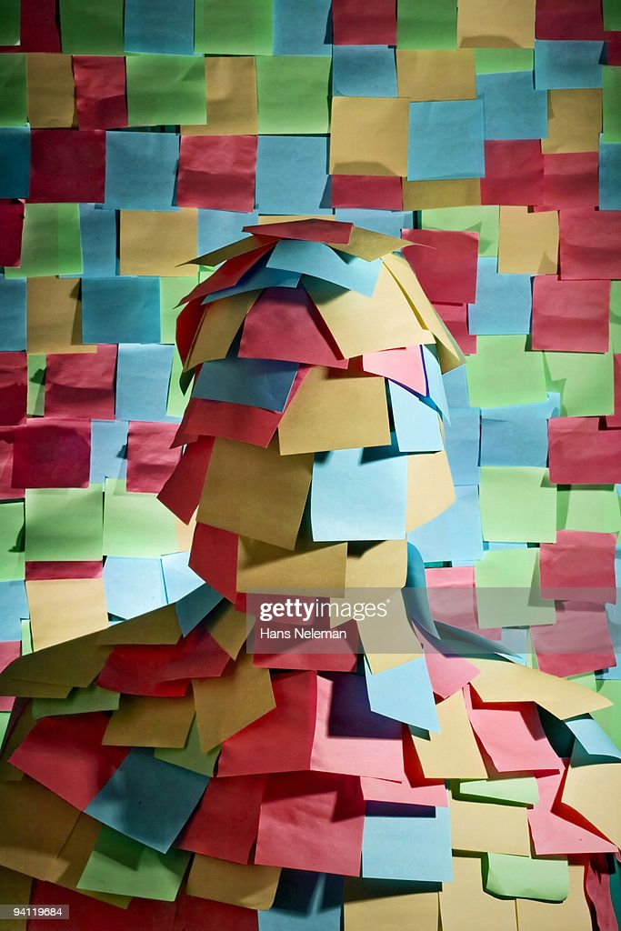 Businessman wrapped in sticky notes, Mexico City, Mexico : Stock Photo