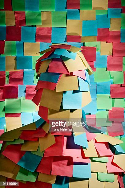 Businessman wrapped in sticky notes, Mexico City, Mexico