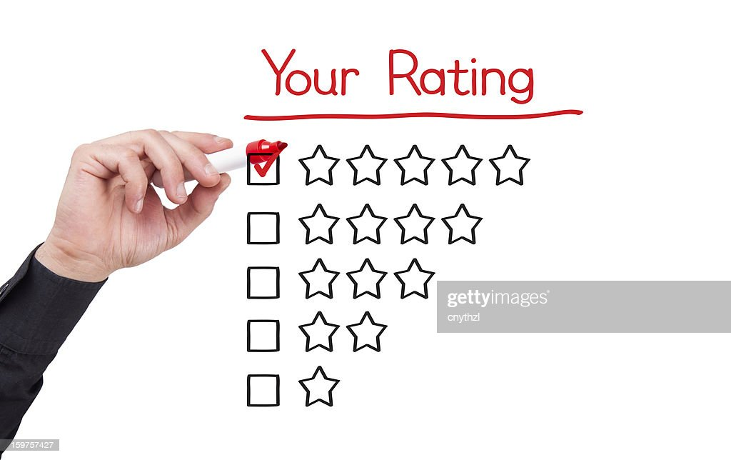 Businessman Writing Five Star Rating : Stock Photo