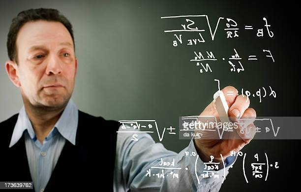 Businessman writing formulas