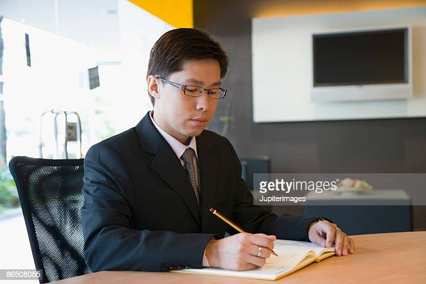 Businessman writing in office