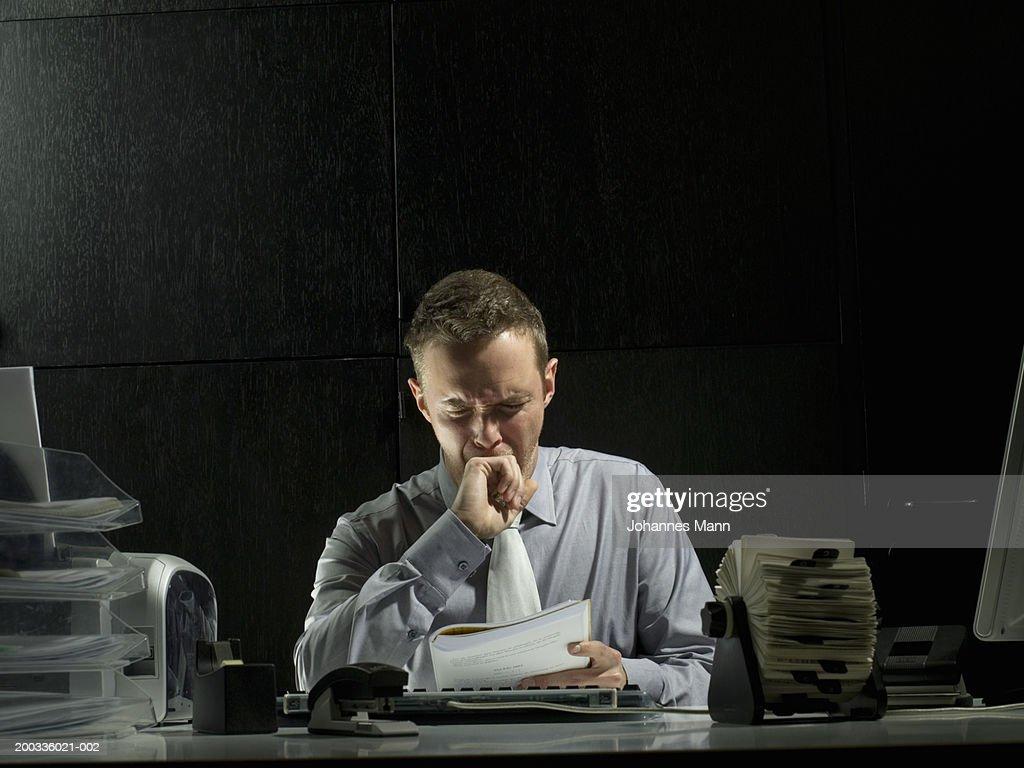 Businessman yawning at desk : Stock Photo