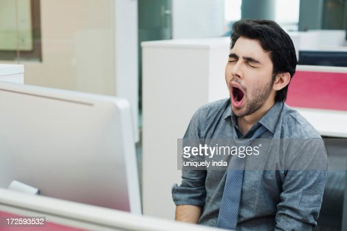Businessman yawning in the office