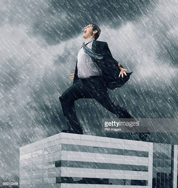 Businessman yelling on the roof