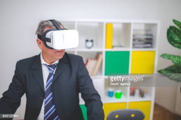 Businessmanan using Virtual Reality Headset