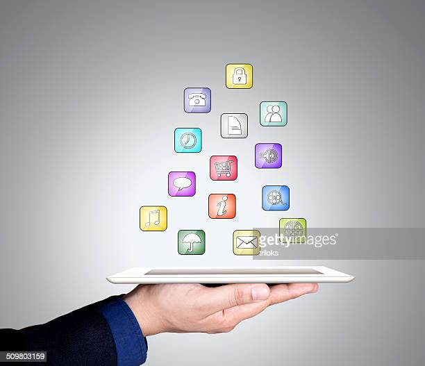 Businessman's hand holding digital tablet with different apps