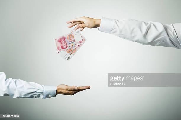 Businessman's hand holding money