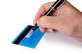 Businessman's hand signing the back of his credit card.