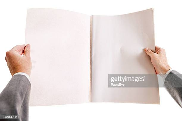 Businessman's hands hold blank newspaper