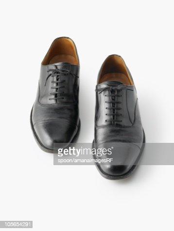 A Businessman's Shoes on a White Background : Foto de stock