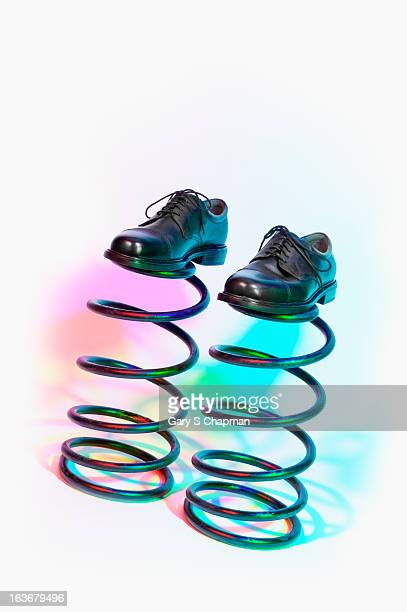 Businessman's shoes on springs
