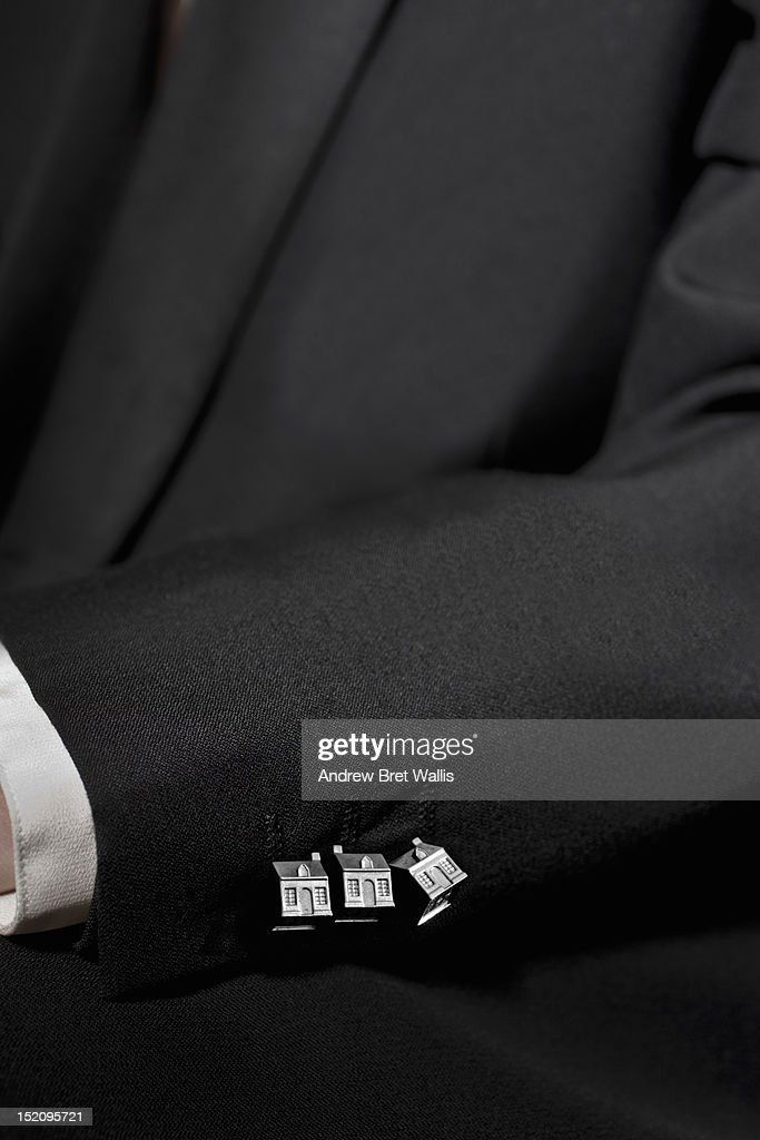 businessman's suit with silver property buttons : Stock Photo
