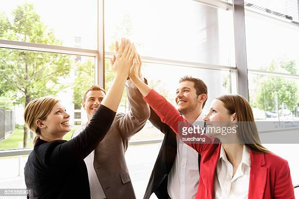 Businessmen and businesswomen cheering