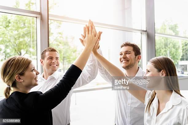 Businessmen and businesswomen cheering
