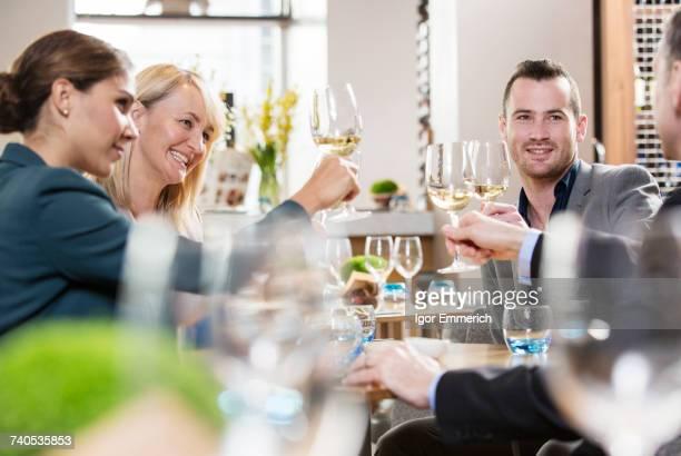 Businessmen and businesswomen toasting