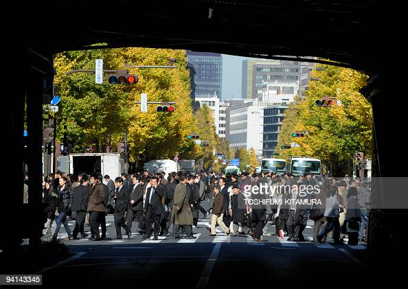 Businessmen and shoppers jam a zebra crossing in Tokyo on December 8 2009 Japan announced a huge 274 billion USD stimulus on December 8 to jumpstart...