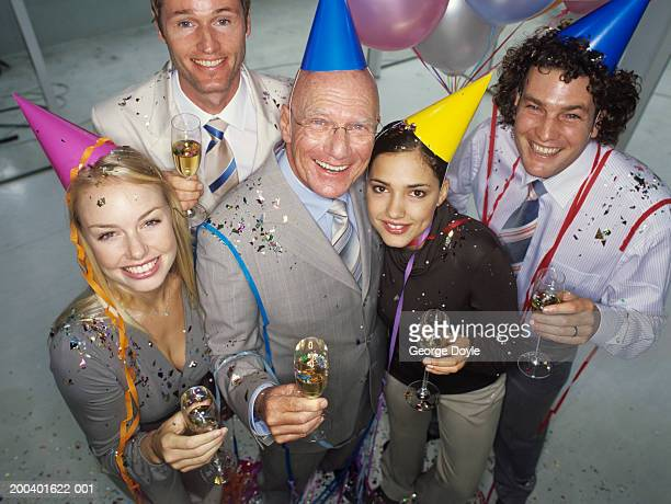 Businessmen and women at office party smiling, portrait, elevated view