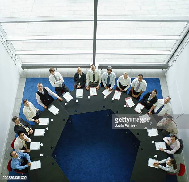 Businessmen and women in meeting at round table, elevated view