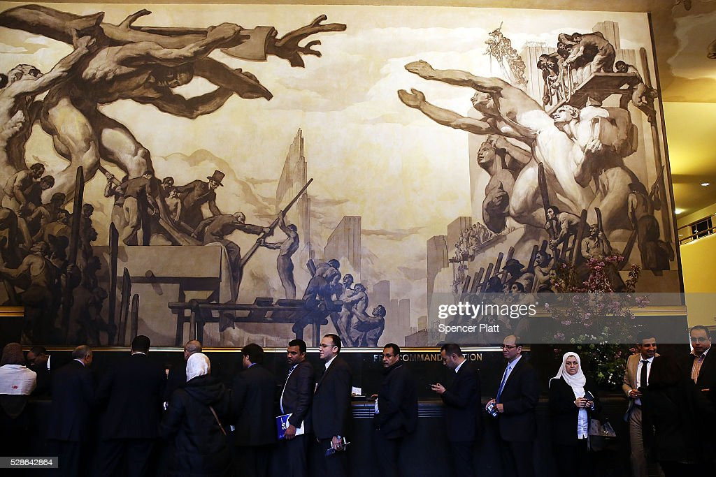 Businessmen and women stand under a mural at Rockefeller Center celebrating American labor on May 06, 2016 in New York, New York. After months of positive economic news, a report released today by the labor Department showed only a 160,000 increase in payrolls in April, far lower than what economists expected. The nation's unemployment rate was unchanged at 5 percent.
