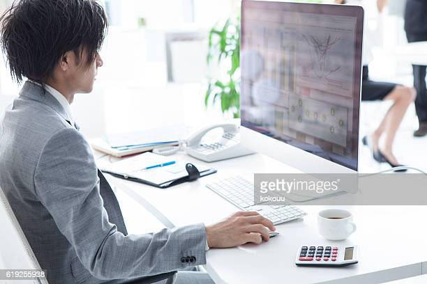 Businessmen are making the documents in the personal computer