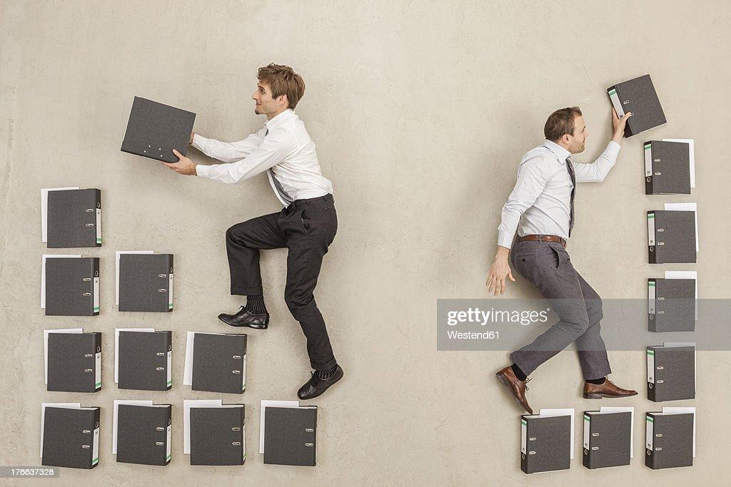 Businessmen arranging files in office