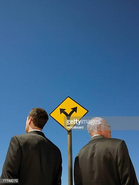 Businessmen at Fork in Road