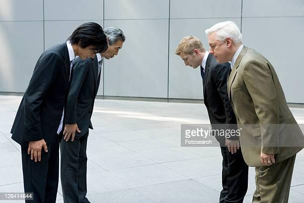 Businessmen Bowing
