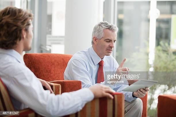 Businessmen brainstorming in office