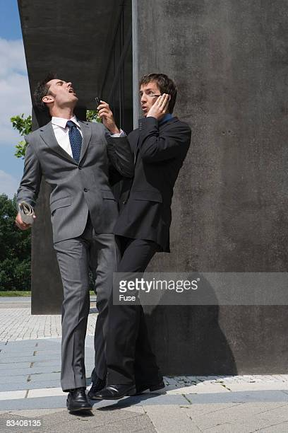 Businessmen Bumping Into Each Other