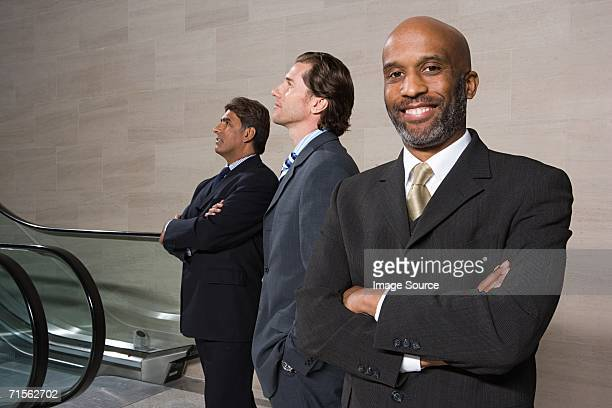 Businessmen by escalator