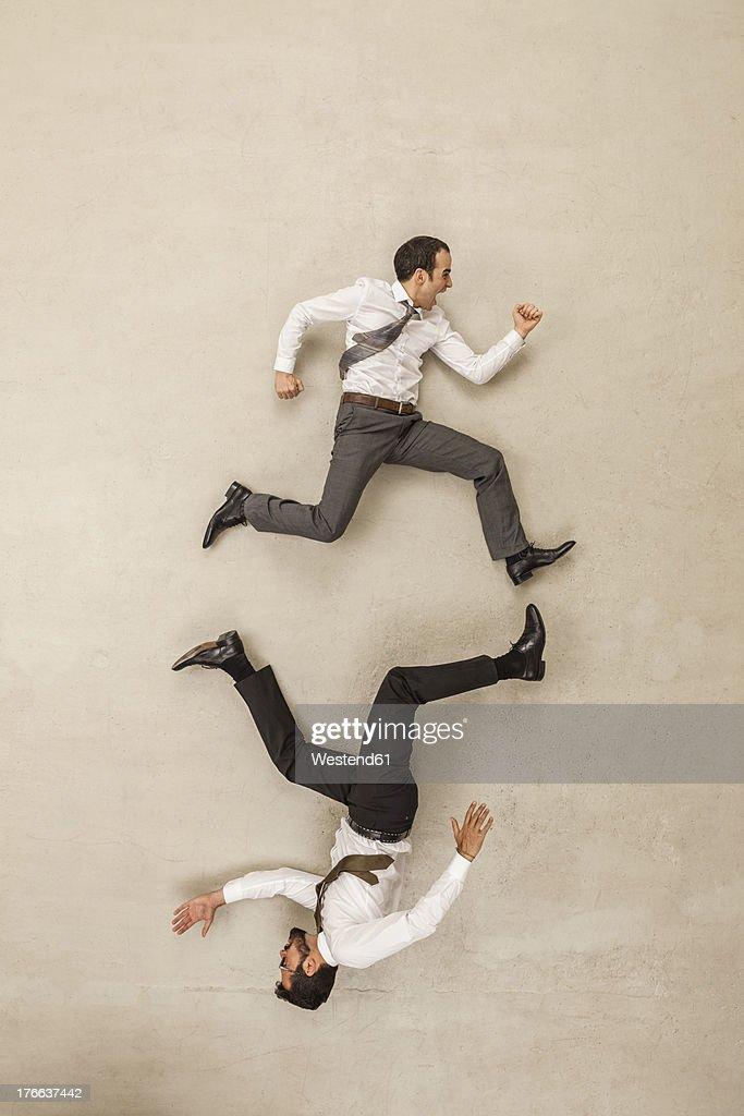 Businessmen chasing in opposite direction
