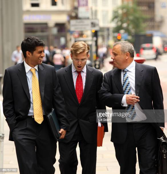 Businessmen chat as they take a lunch break in London's financial district on August 12 2009 in London England The Financial Services Authority have...