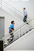 Businessmen climbing staircase