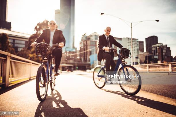 businessmen commuting on the city in melbourne at dusk
