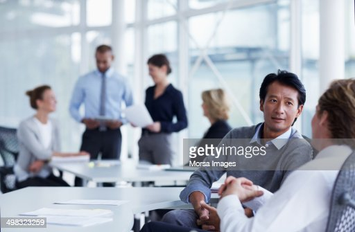 Businessmen discussing in office