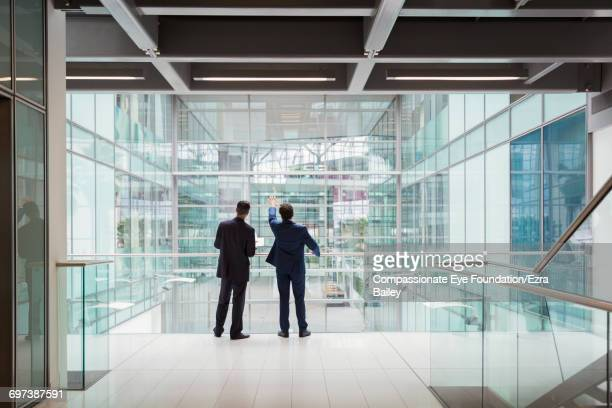 Businessmen discussing plans in modern office