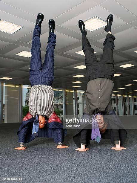 Businessmen Doing Handstands