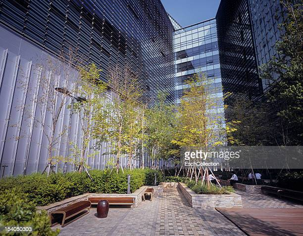 Businessmen enjoying lunch at a modern office park
