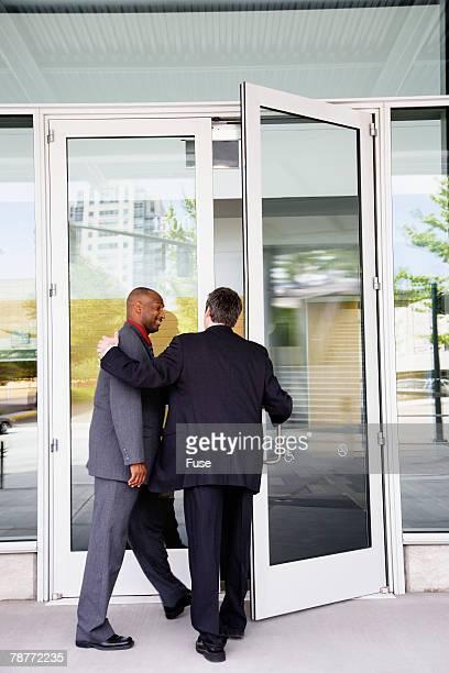 Businessmen Entering Office Building