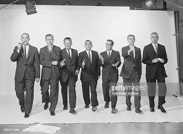 Businessmen extending hand to shake, portrait