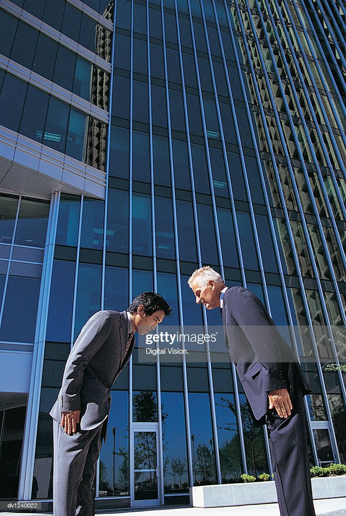 Businessmen Face to Face Bowing