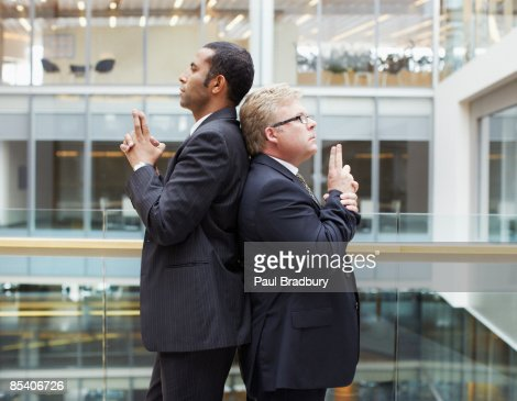 Businessmen fighting symbolic duel