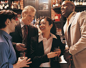 Businessmen Flirting With a Businesswoman in a Bar