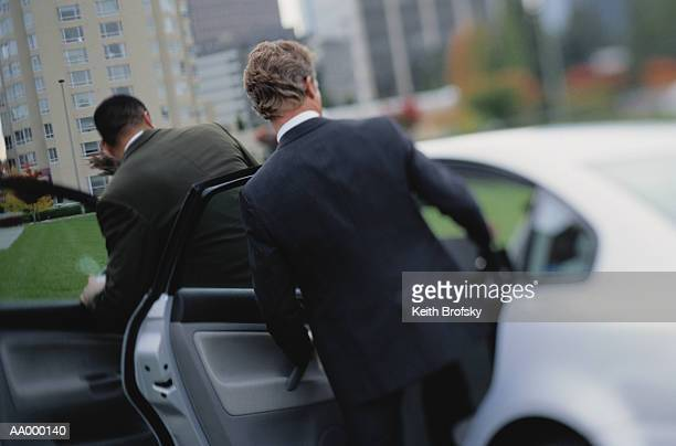 Businessmen Getting Into a Car